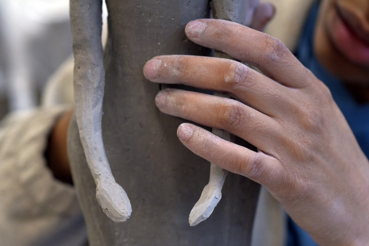 Murjoni Merriweather works on her art at the MICA ceramics studio. (Algerina Perna/Baltimore Sun)