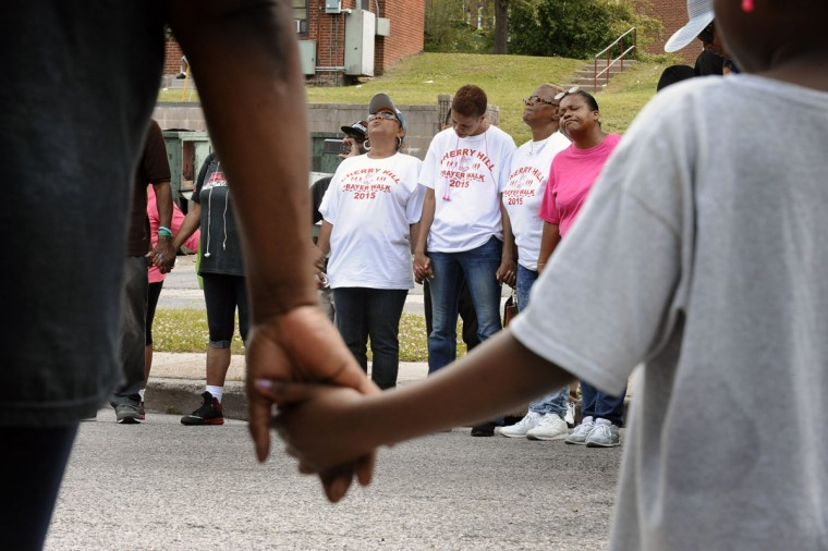 About 150 residents and supporters walked in the Fourth annual Cherry Hill Prayer Walk on June 6, 2015. (Kenneth K. Lam/Baltimore Sun)