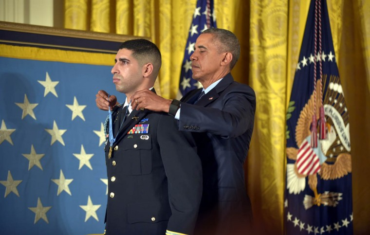 In the White House East Room, President Barack Obama presents Captain Florent A. Groberg, U.S. Army (Ret), the Medal of Honor for conspicuous gallantry for his courageous actions while serving as a Personal Security Detachment Commander for Task Force Mountain Warrior, 4th Infantry Brigade Combat Team, 4th Infantry Division during combat operations in Asadabad, Kunar Province, Afghanistan on August 8, 2012. He is the tenth living recipient to be awarded the Medal of Honor for actions in Afghanistan. (Algerina Perna, Baltimore Sun)