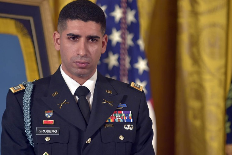 Captain Florent A. Groberg, U.S. Army (Ret) responds as President Barack Obama recounts the incidents which led to Groberg receiving the Medal of Honor. In the White House East Room, President Barack Obama presents Captain Florent A. Groberg, U.S. Army (Ret), the Medal of Honor for conspicuous gallantry for his courageous actions while serving as a Personal Security Detachment Commander for Task Force Mountain Warrior, 4th Infantry Brigade Combat Team, 4th Infantry Division during combat operations in Asadabad, Kunar Province, Afghanistan on August 8, 2012. He is the tenth living recipient to be awarded the Medal of Honor for actions in Afghanistan. (Algerina Perna, Baltimore Sun)
