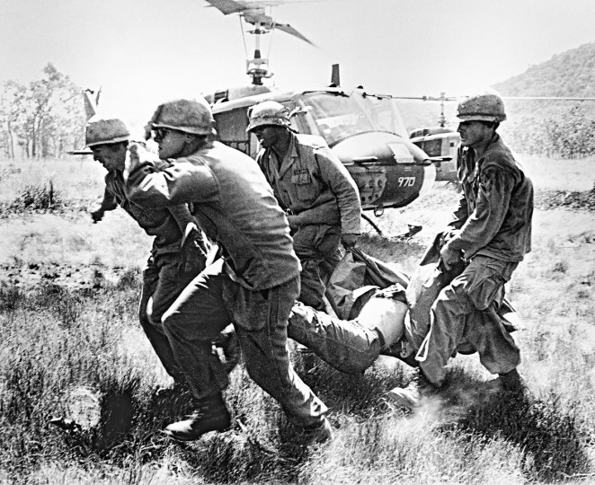 The body of a slain comrade is carried to an evacuation helicopter by soldiers of the U.S. 1st cavalry division in the Ia Drang Valley early in the week of Nov. 15, 1965.  The Air Cavalry Division has suffered the heaviest American losses of the Vietnam War during the battle in the Ia Drang area - a battle that began Nov.14.  (Peter Arnett/AP Photo)