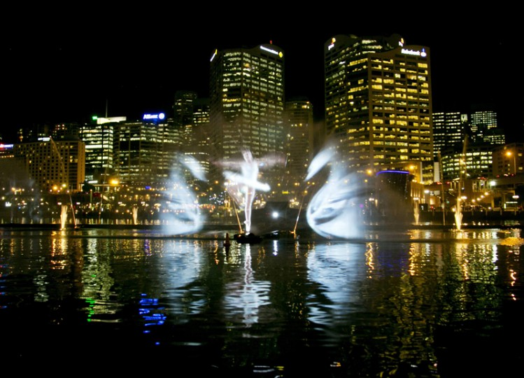 A light show featuring a ballet dancer and swans from Swan Lake is projected onto spraying water by the Vivid Aquatique Water Theatre during a preview of the Vivid Sydney light and music festival May 21, 2014. For 18 days beginning on May 23 the Vivid Sydney festival,  one of the world's largest creative industry forums, combined outdoor lighting sculptures and installations. (Jason Reed/REUTERS)