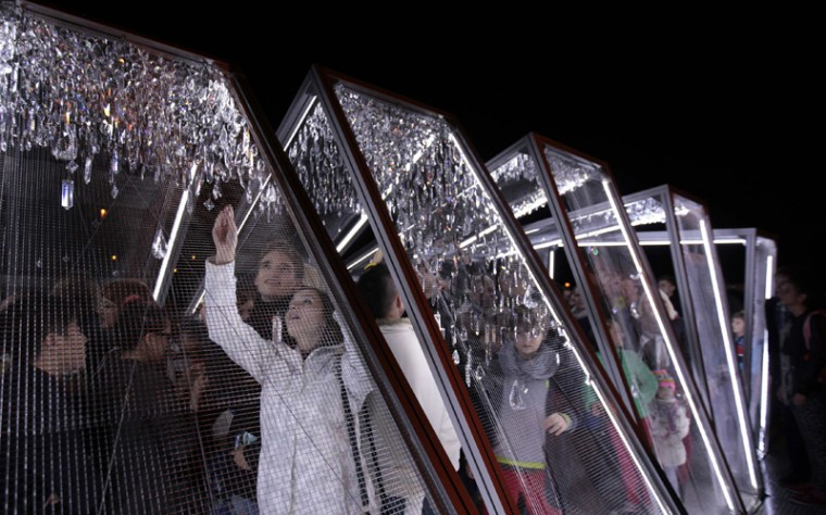 "People walk through the installation ""Crystallation"" during the Signal light festival in Prague Oct. 16, 2014. (David W. Cerny/REUTERS)"