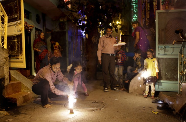Indians play with firecrackers during Diwali celebrations in New Delhi, India, Wednesday, Nov. 11, 2015. Diwali, the festival of lights, is one of Hinduism's most important festivals dedicated to the worship of Lakshmi, the Hindu goddess of wealth. (AP Photo/Altaf Qadri)