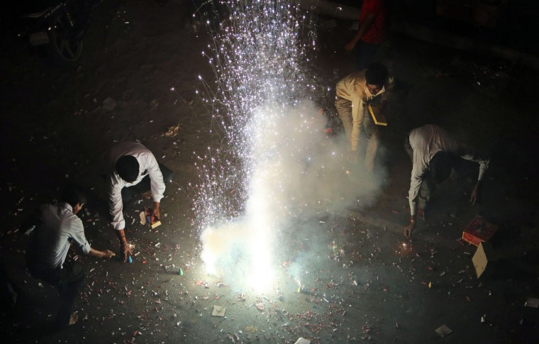 Indians play with firecrackers during Diwali celebrations in Hyderabad, India, Wednesday, Nov. 11, 2015. Diwali, the festival of lights, is one of Hinduism's most important festivals dedicated to the worship of Lakshmi, the Hindu goddess of wealth. (AP Photo/Mahesh Kumar A.)