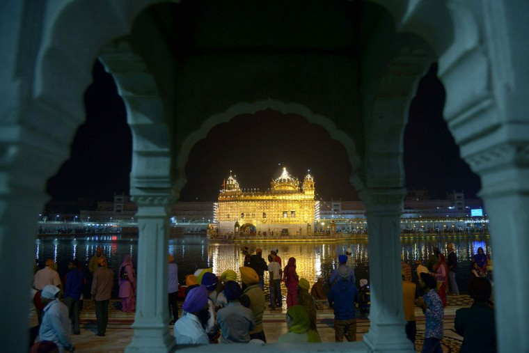 Indian Sikh devotees pay their respects on the occasion of Bandi Chhor Divas or Diwali at the illuminated Sikh shrine Golden temple in Amritsar on November 11,2015 on the occasion of Bandi Chhor Divas, or Diwali. (NARINDER NANU/AFP/Getty Images)