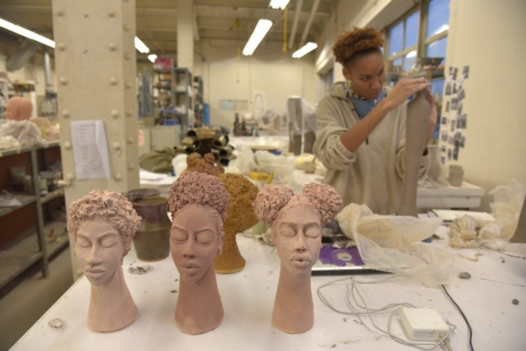 Murjoni Merriweather works on her art at the MICA ceramics studio.She will be participating in the upcoming MICA Art Market.  (Algerina Perna/Baltimore Sun)