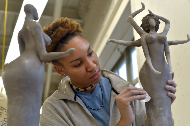 The Hindu Goddess Durga was the inspiration for the sculpture at right. The piece was part wheel-thrown and part hand-built.  The arms will be used to hold jewelry.   (Algerina Perna/Baltimore Sun)