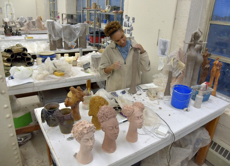 Murjoni Merriweather works on her art at the MICA ceramics studio.She will be participating in the upcoming MICA Art Market. A sophomore ceramics student, Merriweather's figure work focuses on African American culture with an emphasis on natural hair and the female form. (Algerina Perna/Baltimore Sun)