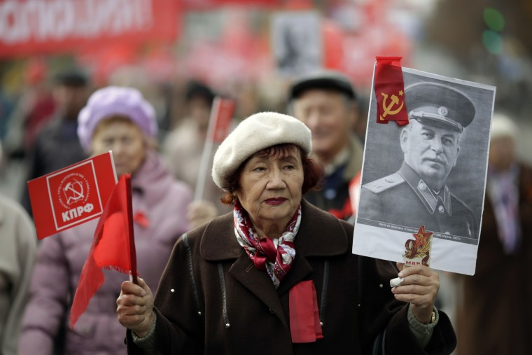 A woman holds pa ortrait of Soviet leader Joseph Stalin during a rally to mark the 98th anniversary of Russia's Bolshevik Revolution in Crimean city of Simferopol on November 7, 2015. (Max Vetrov/AFP-Getty Images)