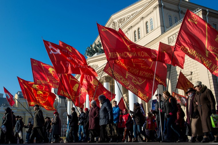 People hold red flags during a rally to mark the 98th anniversary of Russia's Bolshevik Revolution in central Moscow on November 7, 2015. (Dmitry Serebryakov/AFP-Getty Images)