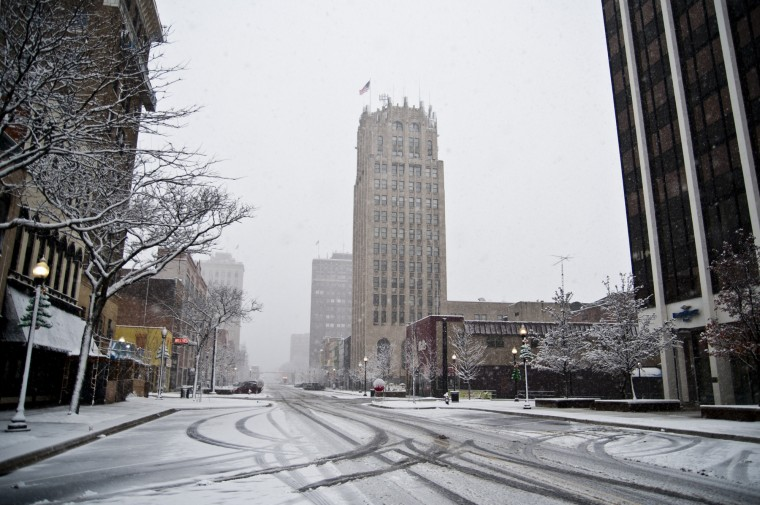 Snow coats over downtown Jackson, Mich., on Saturday, Nov. 21, 2015. The first significant snowstorm of the season blanketed some parts of the Midwest with more than a foot of snow and more was on the way Saturday, creating hazardous travel conditions and flight delays. (Jessica Christian/Jackson Citizen Patriot via AP)