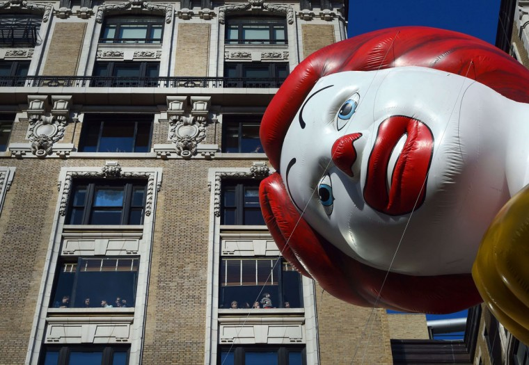People watch as the Ronald McDonald balloon floats during the 89th Annual Macy's Thanksgiving Day Parade on November 26, 2015 in New York City. (TIMOTHY A. CLARY/AFP/Getty Images)