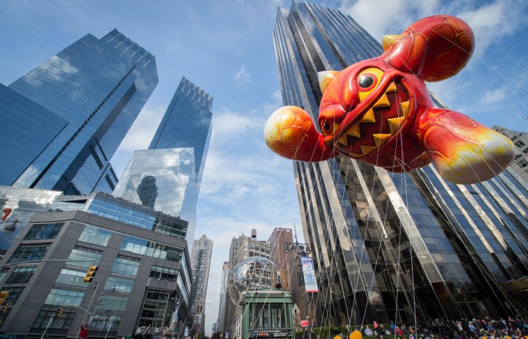 The balloon Skylanders' Eruptor is moved through Columbus Circle during the Macy's Thanksgiving Day Parade, Thursday, Nov. 26, 2015 in New York. (AP Photo/Bryan R. Smith)