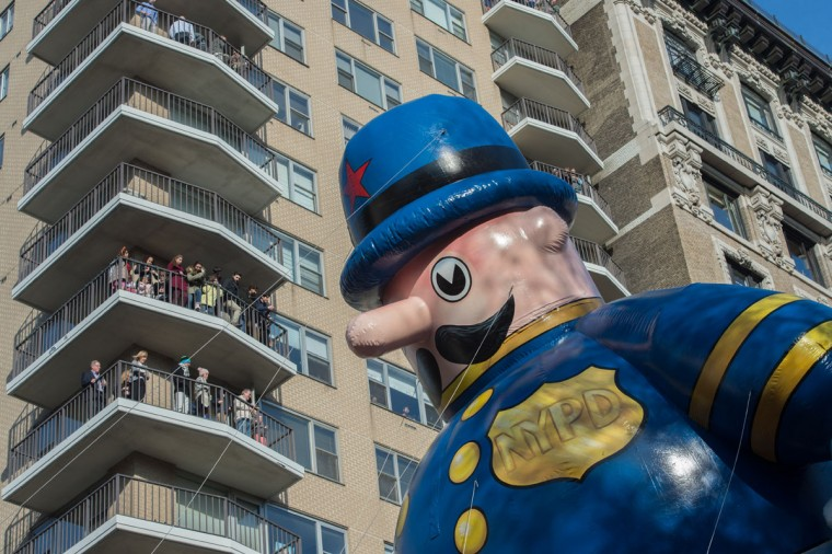 Spectators watch as the balloon Harold The Police Officer is moved down Central Park West during the Macy's Thanksgiving Day Parade, Thursday, Nov. 26, 2015, in New York. (AP Photo/Bryan R. Smith)