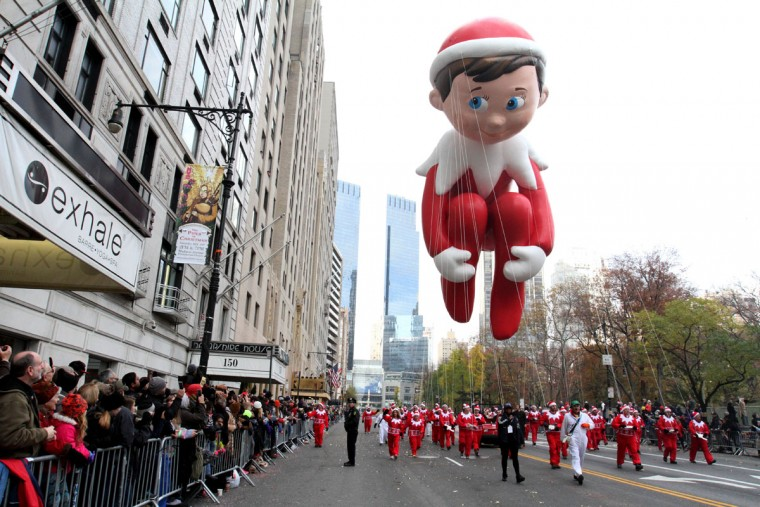 The Elf on the Shelf balloon makes its way across New York's Central Park South during the Macy's Thanksgiving Day Parade, Thursday Nov. 26, 2016. (AP Photo/Tina Fineberg)
