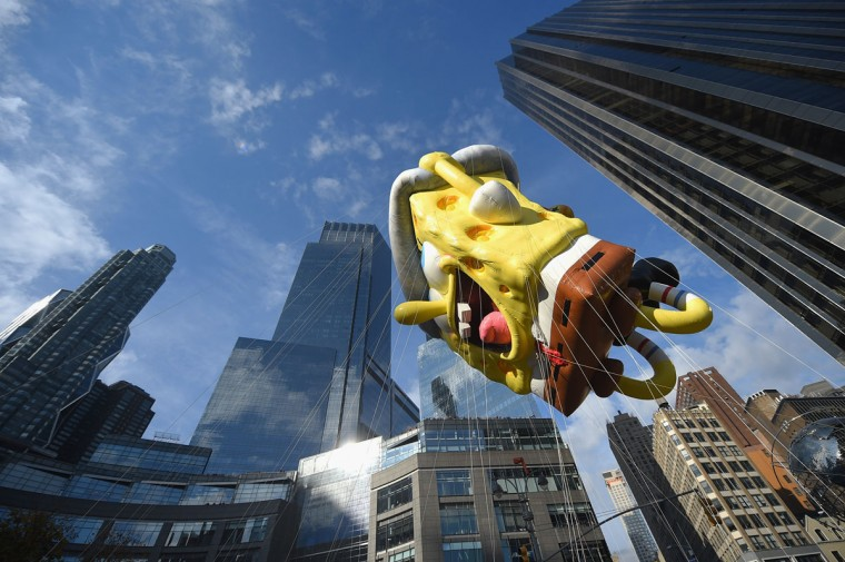The SpongeBob SquarePants balloon floats through the parade route during the 89th Annual Macy's Thanksgiving Day Parade on November 26, 2015 in New York City. (Photo by Michael Loccisano/Getty Images)