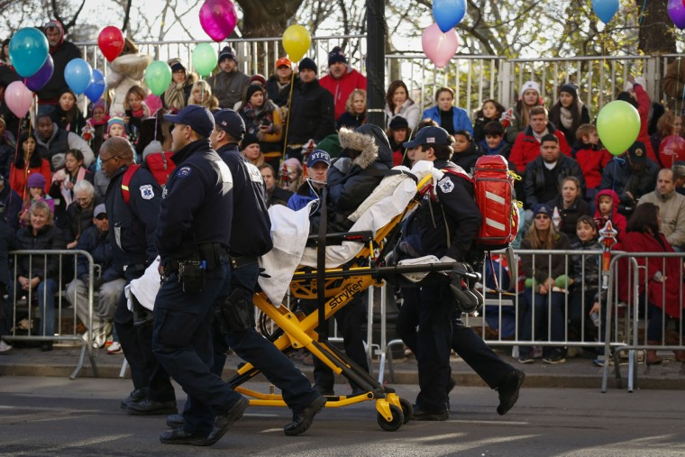 Members of the New York City Police department clear out a woman before the annual Thanksgiving Day Parade on November 26, 2015 in New York City. Security was tight in New York City on Thursday with a record number of police officers patrolling the annual Macy's Thanksgiving parade. (Kena Betancur/Getty Images)