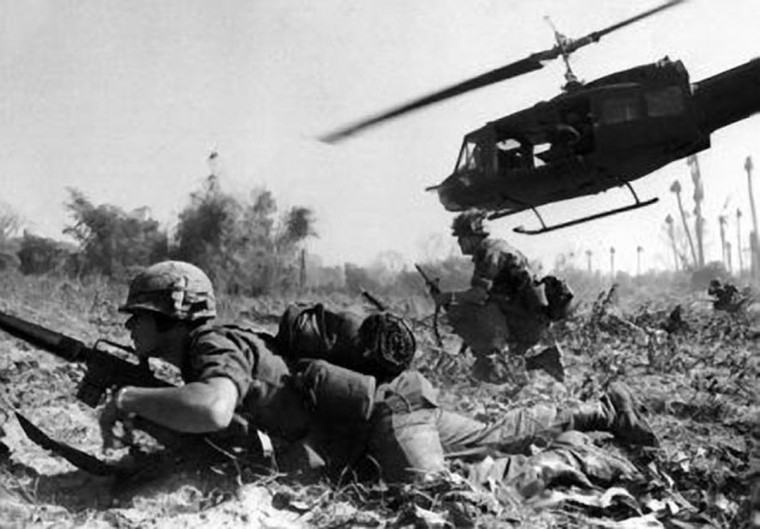 Combat operations at Ia Drang Valley, Vietnam, November 1965. Bruce P. Crandall's UH-1 Huey dispatches infantry while under fire.  (US Army photo)