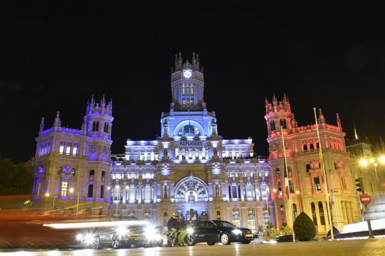 Traffic passes the facade of the Cibeles Palace, Madrid's town hall, illuminated in red, white and blue to represent the French national standard in Madrid on November 14, 2015 in support for victims and families following a series of terror attacks in Paris. (GERARD JULIEN/AFP/Getty Images)