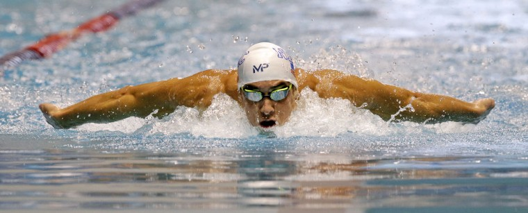 Michael Phelps swims the butterfly leg of the men's 200 meter individual medley in a preliminary race at the U.S. Winter Nationals swimming event Thursday, Dec. 3, 2015, in Federal Way, Wash. (AP Photo/Elaine Thompson)