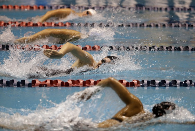 Women race in the final preliminary heat of the 400 meter freestyle during the U.S. Winter Nationals swimming event Thursday, Dec. 3, 2015, in Federal Way, Wash. (AP Photo/Elaine Thompson)
