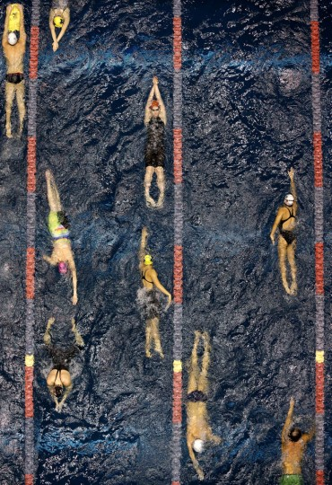 Swimmers warm-up at the U.S. Winter Nationals swimming competition, Thursday, Dec. 3, 2015, in Federal Way, Wash. (AP Photo/Elaine Thompson)