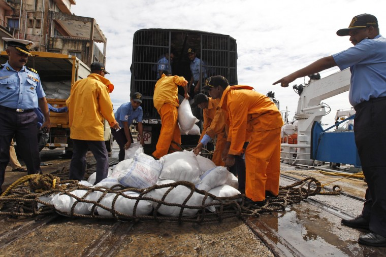 Coastguard sailors load a truck with relief material to be distributed to the flood-affected in Chennai, India, Saturday, Dec. 5, 2015. Although floodwaters have begun to recede, vast swaths of Chennai and neighboring districts were still under 2 1/2 to 3 meters (8 to 10 feet) of water, with tens of thousands of people in state-run relief camps. (AP Photo/Arun Sankar K)