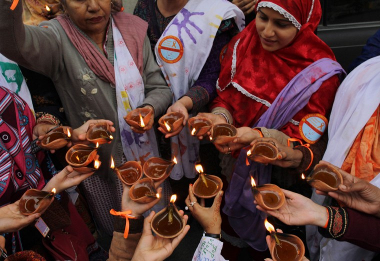 Members of Center For Human Right Education Pakistan hold earthen lamps during a demonstration to mark Human Rights Day, Thursday, Dec. 10, 2015 in Lahore, Pakistan. (AP Photo/K.M. Chaudary)