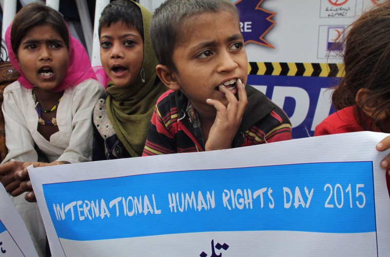 Children listen to a speaker during a demonstration called by members of Center For Human Right Education Pakistan to mark Human Rights Day, Thursday, Dec. 10, 2015 in Lahore, Pakistan. (AP Photo/K.M. Chaudary)