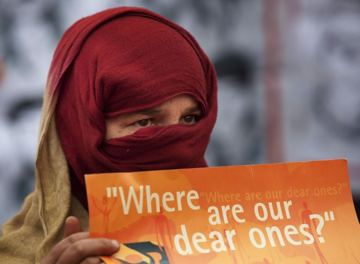 A Kashmiri woman whose relative has gone missing holds a placard at a protest marking International Human Rights Day in Srinagar, India, Thursday, Dec. 10, 2015. According to the Association of Parents of Disappeared Persons (APDP), estimated 8,000-10,000 people are untraceable since the beginning of the Kashmir conflict in 1989, after being arrested by Indian security forces and other security agencies. (AP Photo/Dar Yasin)