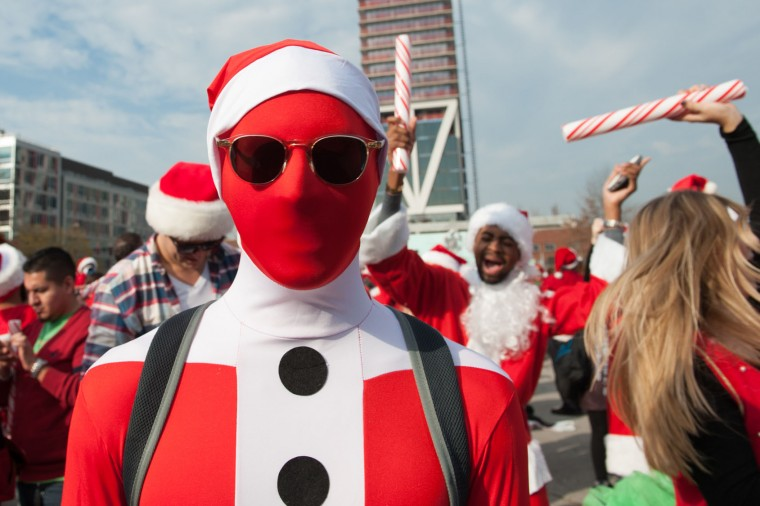 A man dressed as a Santa poses for a photo during the annual SantaCon pub crawl December 12, 2015 in the Brooklyn borough of New York City. Hundreds of revelers take part in the holiday pub crawl, though some local bars and businesses have banned participants in an effort to avoid the typically rowdy SantaCon crowds. (Stephanie Keith/Getty Images)