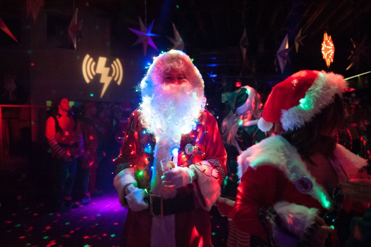 A man dressed as a Santa drinks a cocktail at a club called Verboten during the annual SantaCon pub crawl December 12, 2015 in the Brooklyn borough of New York City. Hundreds of revelers take part in the holiday pub crawl, though some local bars and businesses have banned participants in an effort to avoid the typically rowdy SantaCon crowds. (Stephanie Keith/Getty Images)