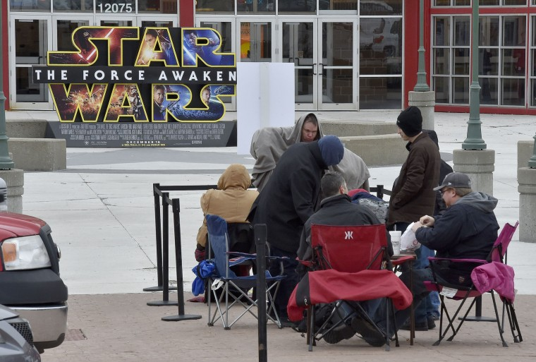 "Fans try to stay warm as they wait in line for ""Star Wars: The Force Awakens"" outside the AMC 28 Theater in Olathe, Kan., on Thursday, Dec. 17, 2015. (John Sleezer/Kansas City Star/TNS)"