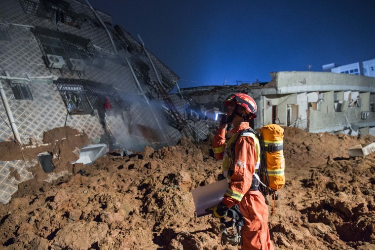 Emergency services search for survivors at an industrial park after a landslide buried 22 buildings on December 20, 2015 in Shenzhen, China. Reports say at least 27 people are missing and 7 people have been rescued so far after a landslide hit China's southern province on Sunday. (Lam Yik Fei/Getty Images)