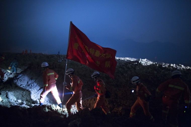 Emergency services search the area after a landslide buried 22 buildings on December 20, 2015 in Shenzhen, China. Reports say at least 27 people are missing and 7 people have been rescued so far after a landslide hit China's southern province on Sunday. (Lam Yik Fei/Getty Images)