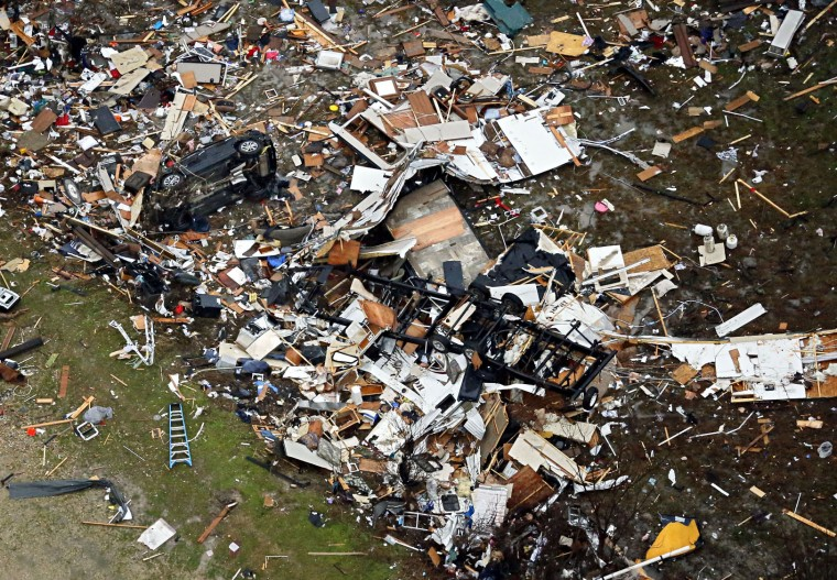 Debris of homes spread out after Saturday's tornado in Garland, Texas, Sunday, Dec. 27, 2015. At least 11 people died and dozens were injured in apparently strong tornadoes that swept through the Dallas area and caused substantial damage this weekend. (G.J. McCarthy/The Dallas Morning News via AP)