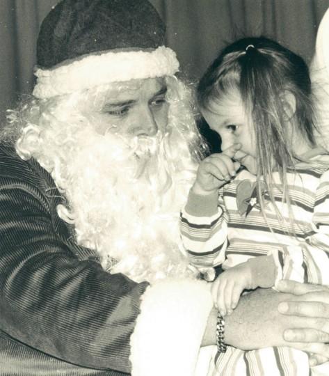 Rachel Caras, 3, sits on Santa's lap at Dasher Green Elementary School. (Baltimore Sun archives, 1988)