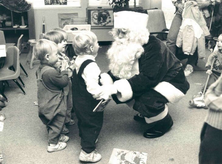 """Santa, aka Phillip Bundy III, president of the non-profit """"Children Favorite Things,"""" visits the Up County Family Support Center where he was guest of honor at the Christmas party and distributed gifts for kids to unwrap on Christmas. (Barbara Haddock/Baltimore Sun, 1991)"""