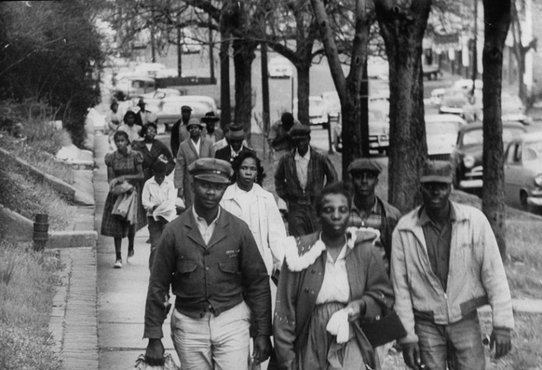 African Americans walk to work instead of riding the bus during the third month of an eventual 381-day bus boycott, in Montgomery, Alabama, February 1956. This photo was part of the 381 Days: The Montgomery Bus Boycott Story exhibit at the Reginald F. Lewis Museum. (Don Cravens/Time Life Pictures/Getty Images)