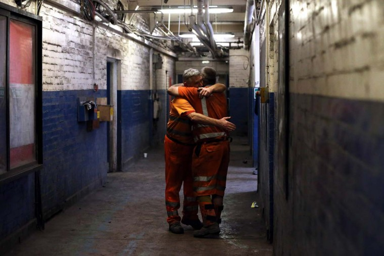 KNOTTINGLEY, ENGLAND - DECEMBER 18:  Miners embrace each other after their last shift at Kellingley Colliery on December 18, 2015 in Knottingley, England. Kellingley began production in 1965 and is the UK's last deep coal mine. Its closure will complete a carefully managed two-year plan for the UKs deep mines. This has been implemented by UK Coal with financial support from the British government. It follows a long period of difficult trading conditions largely due to low international coal prices.||Photo by Nigel Roddis - Getty Images