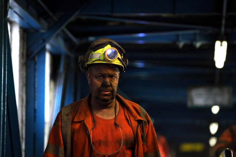KNOTTINGLEY, ENGLAND - DECEMBER 18:  A miner reacts after his last shift at Kellingley Colliery on December 18, 2015 in Knottingley, England. Kellingley began production in 1965 and is the UK's last deep coal mine. Its closure will complete a carefully managed two-year plan for the UKs deep mines. This has been implemented by UK Coal with financial support from the British government. It follows a long period of difficult trading conditions largely due to low international coal prices. ||Photo by Nigel Roddis - Getty Images