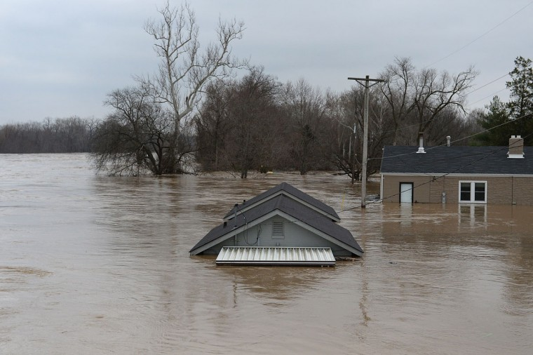 A home is completely submerged on December 30, 2015 in Fenton, Missouri. The St. Louis area and surrounding region experiencing record flood crests of the Mississippi, Missouri and Meremac Rivers after days of record rainfall. (Photo by Michael B. Thomas/Getty Images)