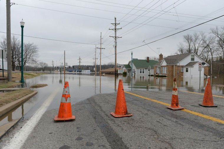 A road block is shown on Gravois Road as water continues to rise into town on December 30, 2015 in Fenton, Missouri. The St. Louis area and surrounding region experiencing record flood crests of the Mississippi, Missouri and Meremac Rivers after days of record rainfall. (Photo by Michael B. Thomas/Getty Images)