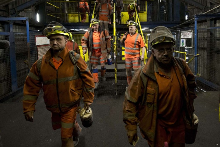 Coal miners are pictured after finishing the final shift at the Kellingley Colliery in Yorkshire, northern England, on December 18, 2015. The shutdown of the mine in Yorkshire in northern England closes a 200-year chapter of Britain's industrial history.  || CREDIT: OLI SCARFF - AFP/GETTY IMAGES