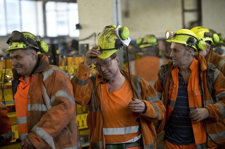 Coal miners are pictured as they finish the last shift at the Kellingley Colliery in Yorkshire, northern England, on December 18, 2015, on the mine's last operational day. The shutdown of the mine in Yorkshire in northern England closes a 200-year chapter of Britain's industrial history.  || CREDIT: OLI SCARFF - AFP/GETTY IMAGES