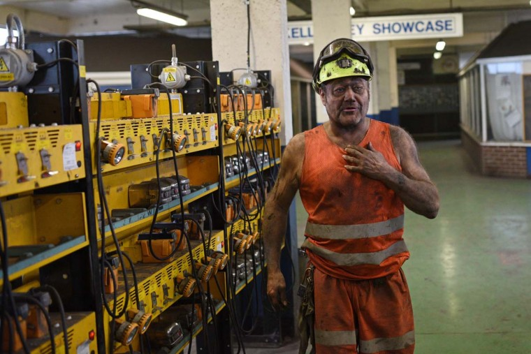 Coal miner Garry Ward is pictured in the Lamp Room as he finishes the final shift at the Kellingley Colliery in Yorkshire, northern England, on December 18, 2015, on the mine's last operational day. The shutdown of the mine in Yorkshire in northern England closes a 200-year chapter of Britain's industrial history.  || CREDIT: OLI SCARFF - AFP/GETTY IMAGES