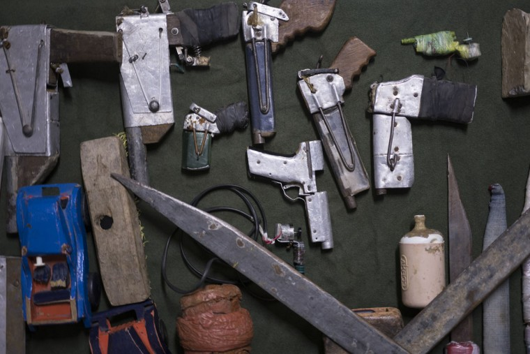 In this Dec. 1, 2015 photo, handmade weapons and tools found in inmates' cells lay on display at the Central Prison in Porto Alegre, Brazil. A recently installed scanner has reduced the number of cell phones, drugs and razor blades that are smuggled into the prison by visiting relatives. But many of these items are often thrown over the prison walls and retrieved by waiting inmates. (AP Photo/Felipe Dana)