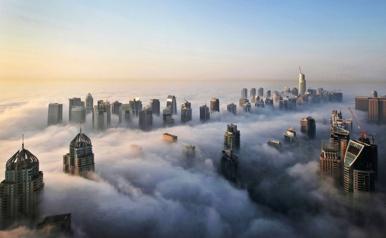 In this Monday, Oct. 5, 2015 photo, a thick blanket of early morning fog partially shrouds the skyscrapers of the Marina and Jumeirah Lake Towers districts of Dubai, United Arab Emirates. Dubai''s rapid transformation from a desert outpost into one of the world''s most architecturally stunning cities is mapped out in the Marina. Where just 15 years ago there was empty, flat land, today a bustling neighborhood thrives centered around a canal and an impressive skyline that pierces through the clouds. (AP Photo/Kamran Jebreili)