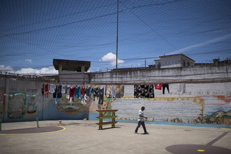 In this Nov. 30, 2015 photo, an inmate walks outside in the patio of a cell block where working prisoners are housed at the Central Prison in Porto Alegre, Brazil. The Central Prison in Porto Alegre has been called out in Human Rights Watch reports for its particular brutality, both prisoner-on-prisoner and for how inmates are treated. At this prison, most only get two hours of sunlight a week. (AP Photo/Felipe Dana)